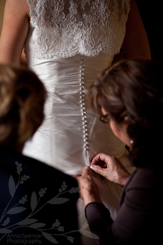 Valeria getting dressed in her wedding gown for her destination wedding in bedizzole, Italy
