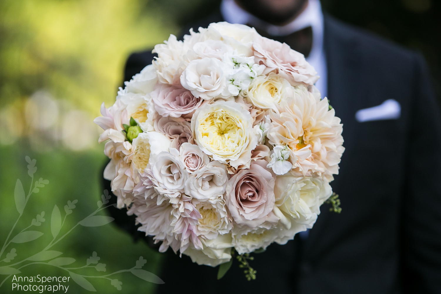 Brides dusty pink rose and white peony bouquet