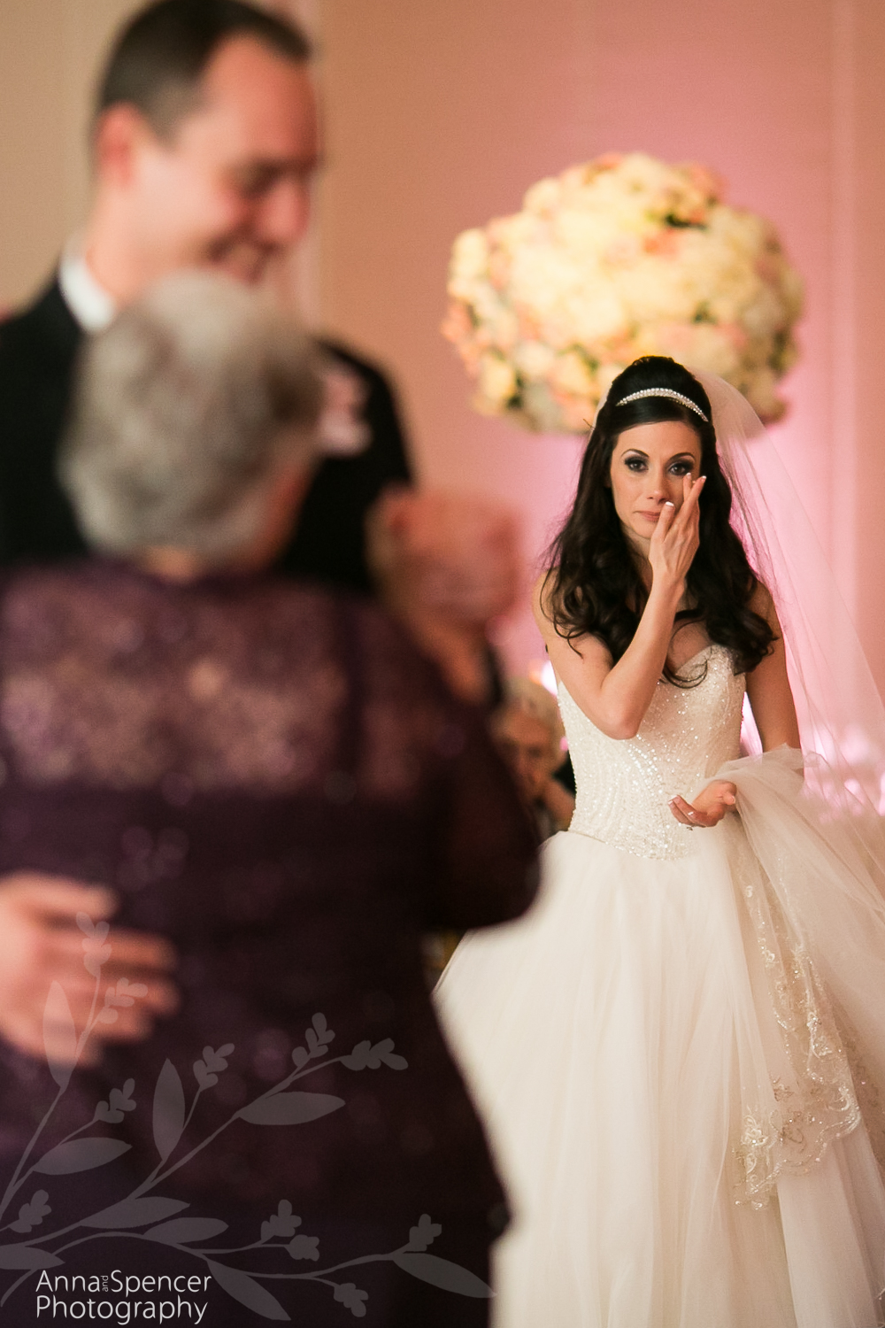 Bride crying during the mother son dance