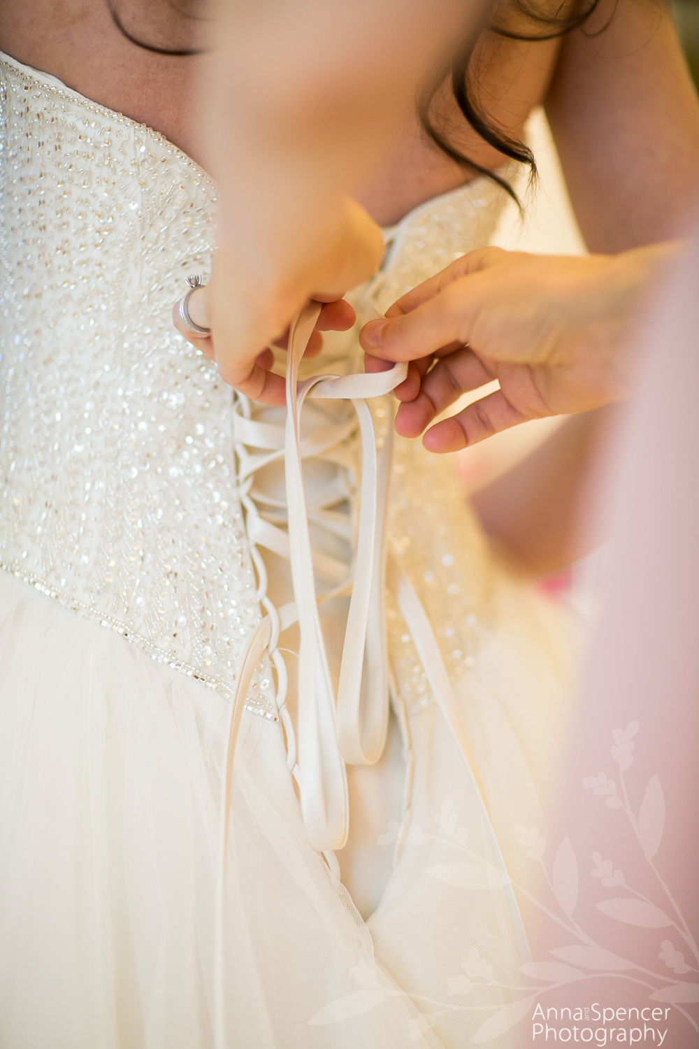 Lacing up a wedding dress corset