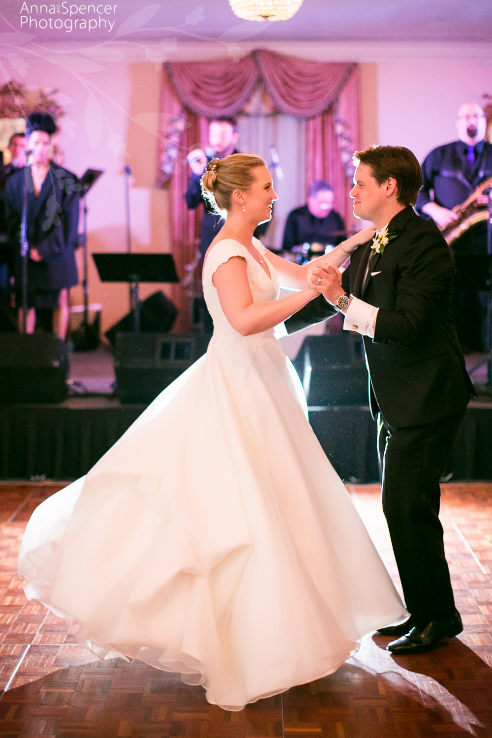 Bride and grooms first dance in a ballroom