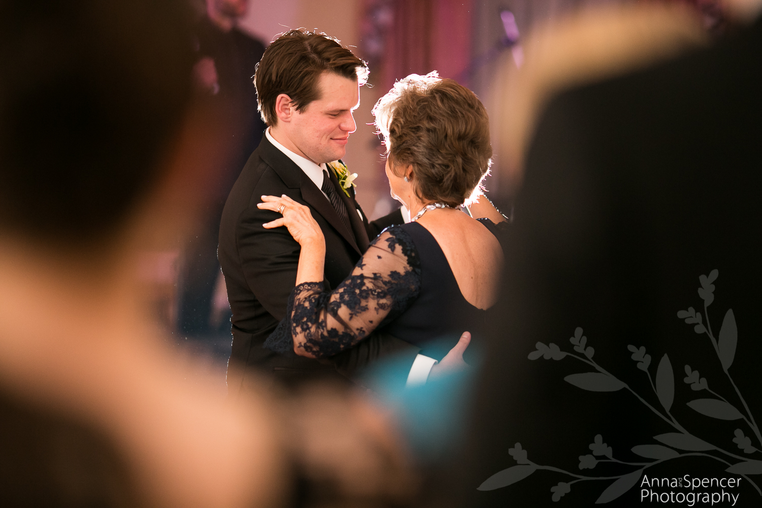 Mother and son dancing at a wedding