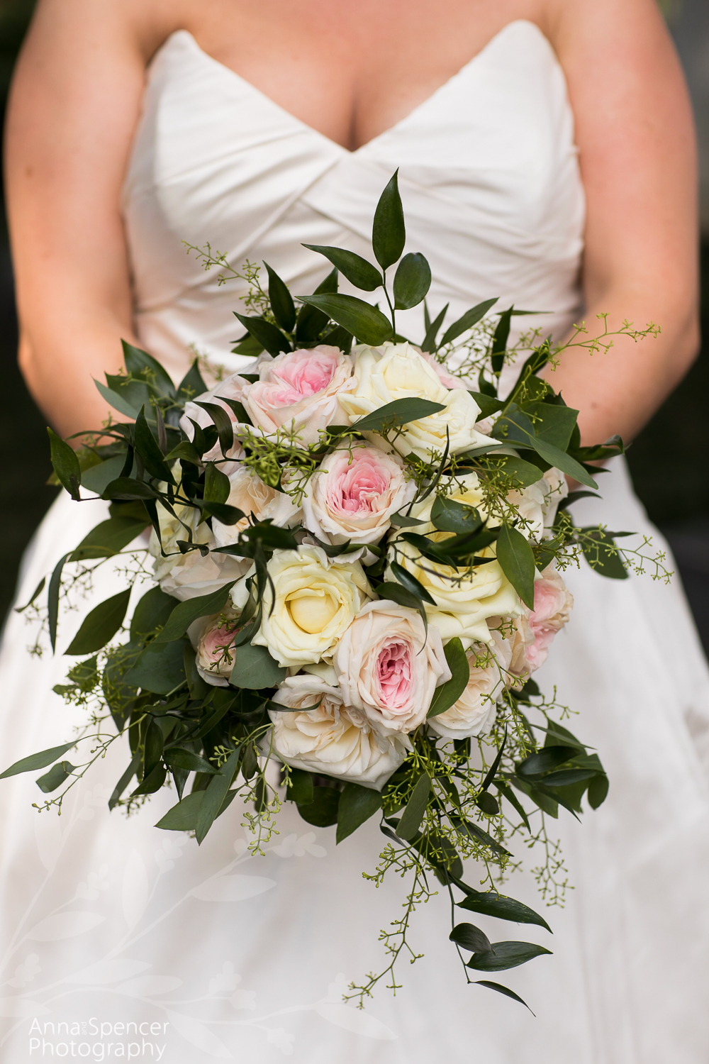 Brides pink and yellow rose bouquet
